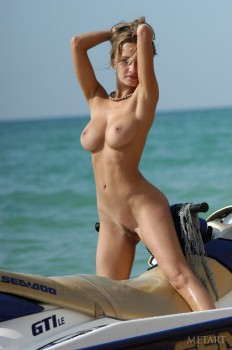 Wild girl doing some naked jet skiing