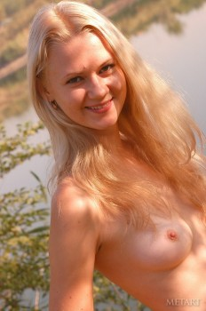 Sexy young model is happy to have solo outdoors