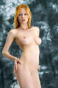 Fiery redhead has fun getting naked