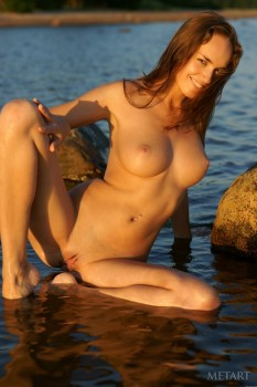 Hot babe swims totally naked in warm water.