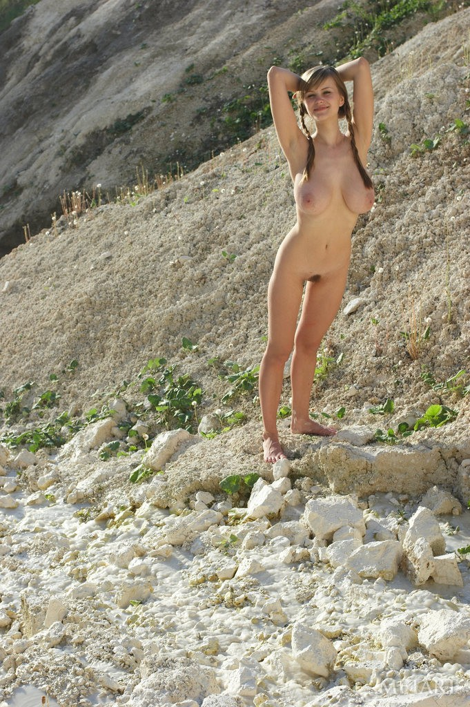 busty cutie shows hairy pussy in the rocks - simplemetart