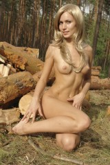Tender blonde is touching herself outdoors