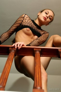 Fishnets and nudity on the stairs