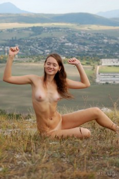 Skinny babe is enjoying solo outdoors