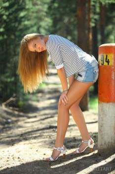 Wonderful madam with high heels is having solo outdoors