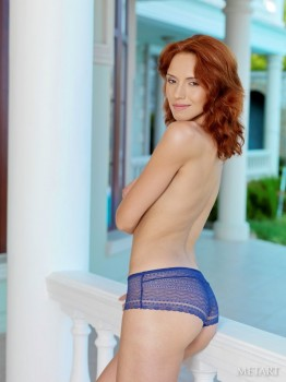 Simply flawless redhead naked on the porch