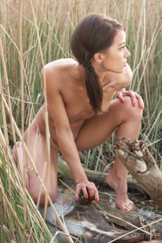 Young model is enjoying outdoors solo with pleasure