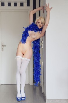 Blonde wearing sexy white stockings is having solo