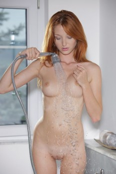 Sexy redhead has a relaxing shower