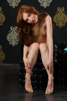 Long-legged babe opens wet pussy on camera.