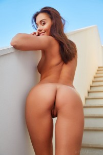 Hottie caresses shaved pussy on stairs