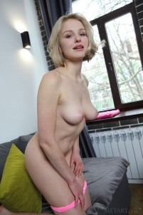 Blondie undresses to give a close-up view of her pussy