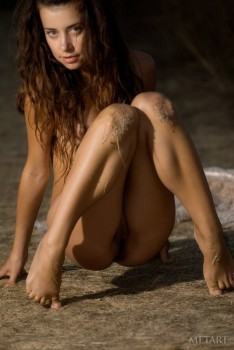 Tender brunette is enjoying solo on the beach