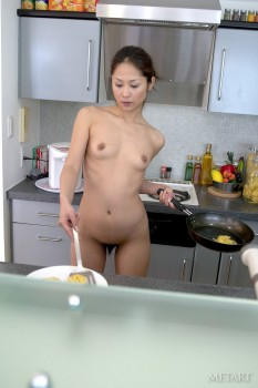Beautiful Asian babe is demonstrating solo skills