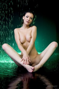 Sweet brunette is getting naked and wet