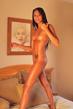 Oiled cutie rubs her totally naked body.