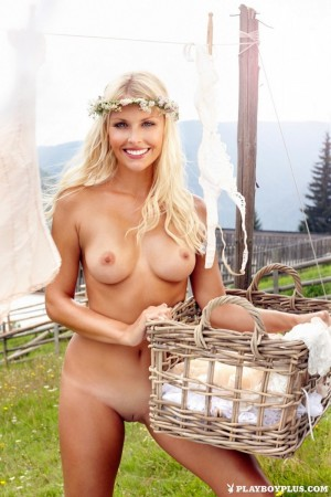 Blonde poses naked in an isolated place